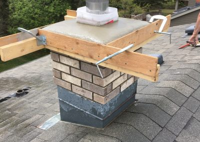 Brick chimney rebuild with new cap